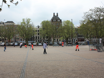sanitation workers (bright pink) playing football with pre-teens