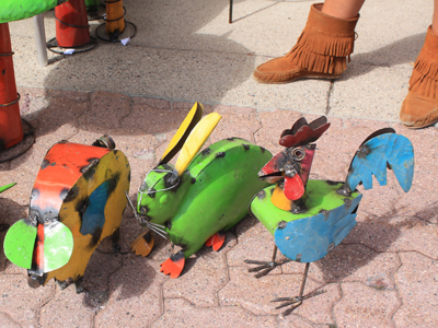 the girl with the cool boots didn't want to tell me the tin sculptures were made in mexico